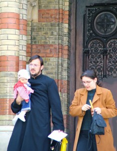 priest_with_family